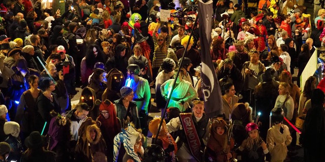 A crowd of people in costumes