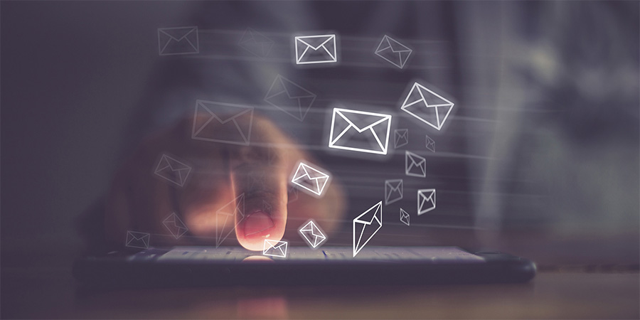 Image of a male checking email