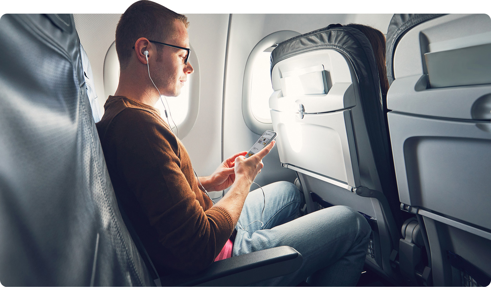 Man on airplane using the onDemand product